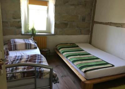 Zimmer im Seminarort 'Gute Laune Hof' von Aeracura